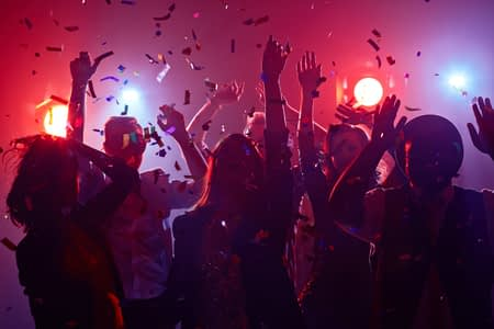 49526410 - young people dancing in night club